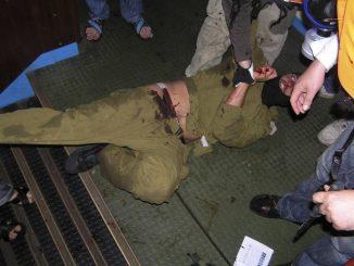 Pro-Palestinian activists hold down an Israeli commando on the Gaza-bound Turkish ship Mavi Marmara in international waters