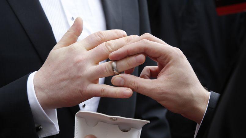 Gay couple Schmitt and Nicolai exchange rings after being married by Copenhagen's mayor in Copenhagen