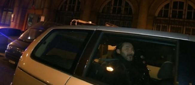 Jean-Luc Germani, dans une voiture de la police Française, quelques heures après son arrestation.