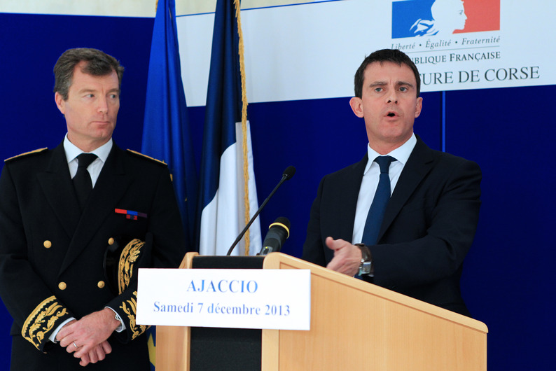 French Interior minister Manuel Valls (R) delivers a speech next to Southtern Corsica Prefect Christophe Mirmand (L), during a visit at the Ajaccio's gendarmerie station two days after the building was hit by rockets, on December 7, 2013 in the French Mediterranean island of Corsica. AFP PHOTO / PASCAL POCHARD-CASABIANCA